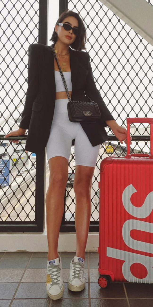 white-shorts-cycling-bike-black-bag-necklace-sun-lob-hairr-white-bralette-white-shoe-sneakers-travel-airport-outfit-black-jacket-blazer-spring-summer-weekend.jpg