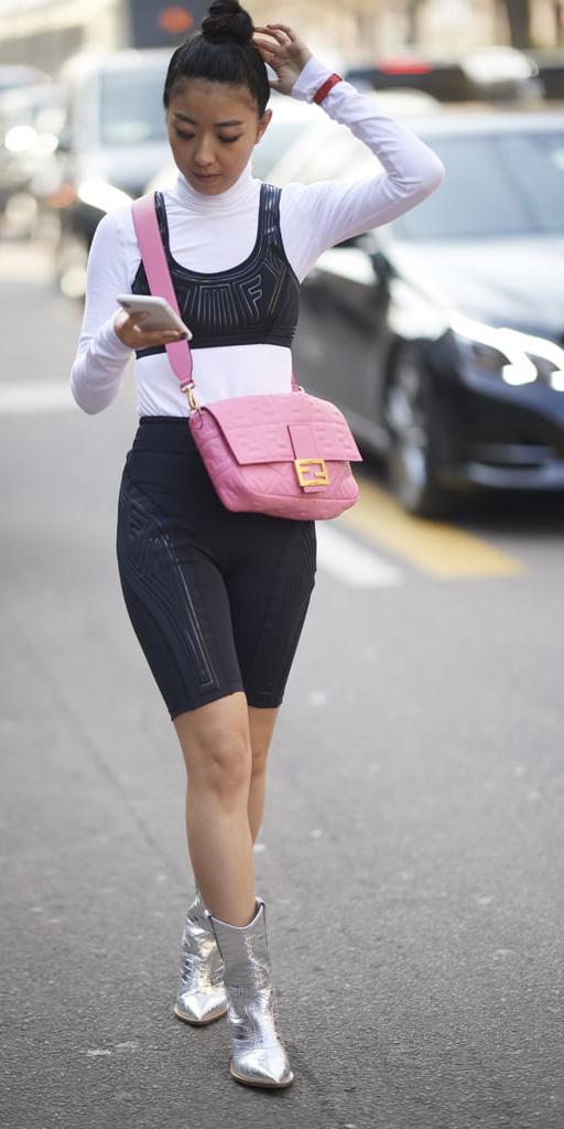 black-shorts-cycling-bike-cowboy-gray-shoe-boots-metallic-pink-bag-white-tee-turtleneck-layer-black-bralette-brun-bun-athleisure-trend-spring-summer-lunch.jpg