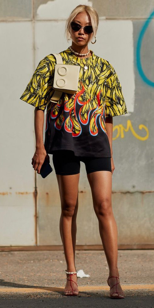 black-shorts-cycling-bike-yellow-graphic-tee-oversized-tan-bag-fannypack-choker-necklace-hoops-blonde-sun-red-shoe-sandalh-anklet-streetstyle-spring-summer-lunch.jpg