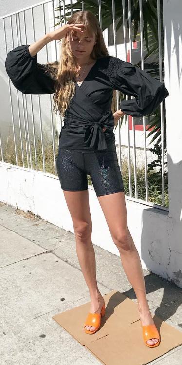 black-shorts-cycling-bike-metallic-black-top-blouse-wrap-blonde-necklace-orange-shoe-sandalh-mules-spring-summer-lunch.jpg