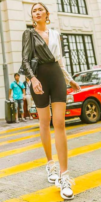 black-shorts-cycling-bike-black-top-blouse-black-bag-white-shoe-sneakers-earrings-statement-hairr-spring-summer-lunch.jpg