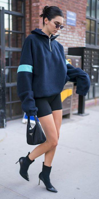 black-shorts-cycling-bike-blue-navy-sweater-oversized-brun-bun-sun-black-bag-black-shoe-booties-kendalljenner-spring-summer-weekend.jpg