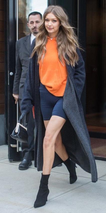 black-shorts-cycling-bike-orange-sweater-hoodie-black-jacket-coatigan-hairr-gigihadid-black-bag-black-shoe-booties-fall-winter-weekend.jpg