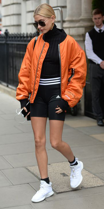 black-shorts-cycling-biker-black-tee-turtleneck-orange-jacket-bomber-blonde-bun-sun-hoops-socks-white-shoe-sneakers-dad-chunky-haileybaldwin-fall-winter-weekend.jpg