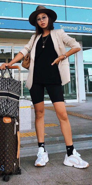 black-shorts-cycling-bike-socks-hat-necklace-travel-airport-style-white-shoe-sneakers-tan-jacket-blazer-black-tee-brun-fall-winter-weekend.jpg
