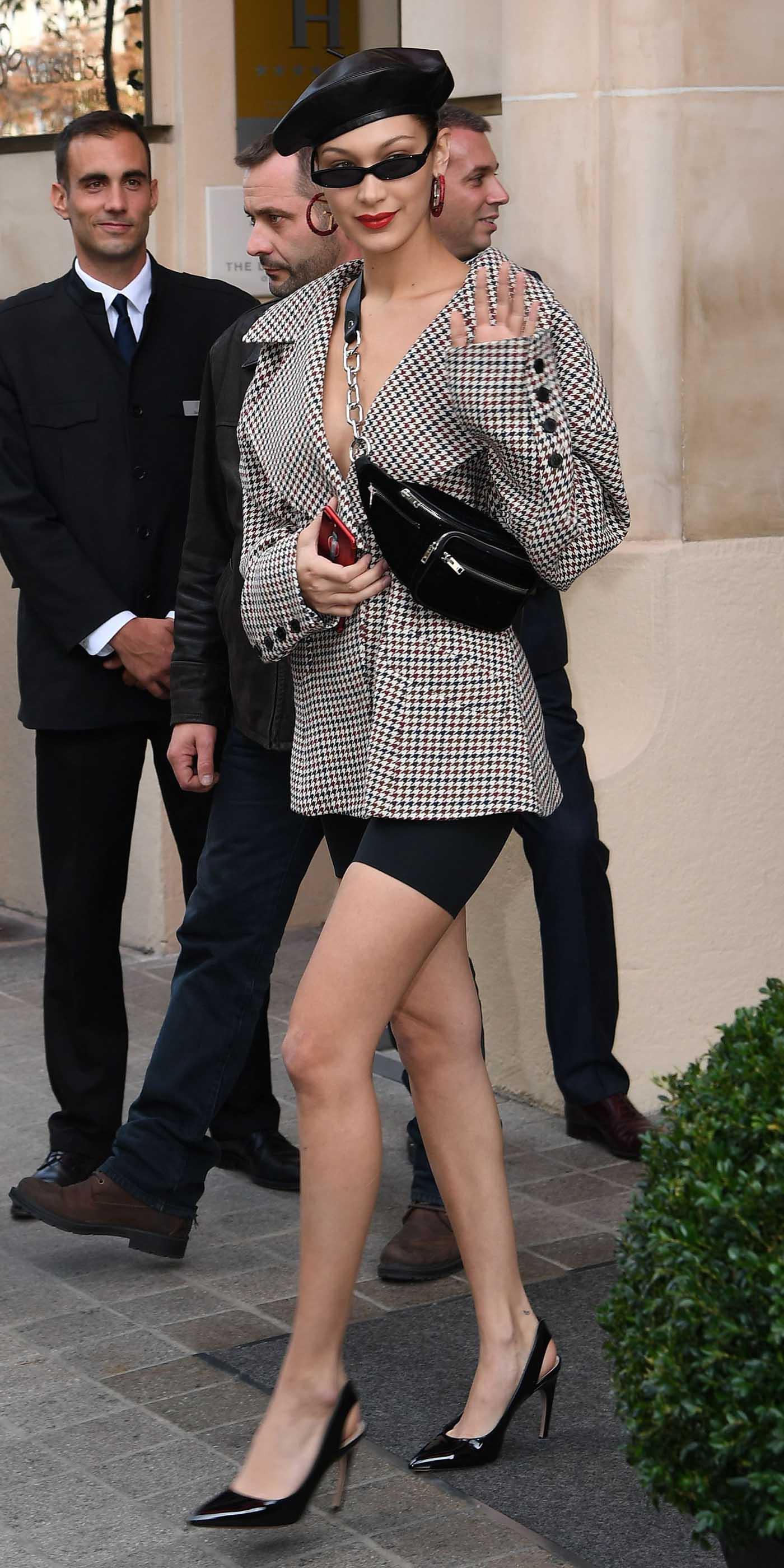 black-shorts-cycling-bike-white-jacket-blazer-houndstooth-print-sun-hat-beret-black-bag-fannypack-black-shoe-pumps-hoops-bellahadid-celebrity-style-fall-winter-lunch.jpg