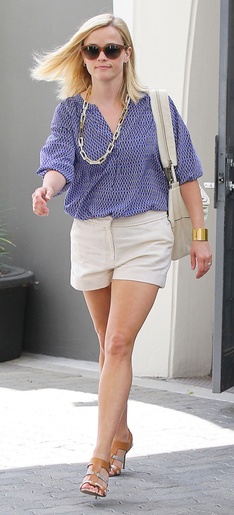 white-shorts-blue-med-top-blouse-tucked-chain-necklace-tan-shoe-sandalh-white-bag-sun-reesewitherspoon-spring-blonde-lunch.jpg