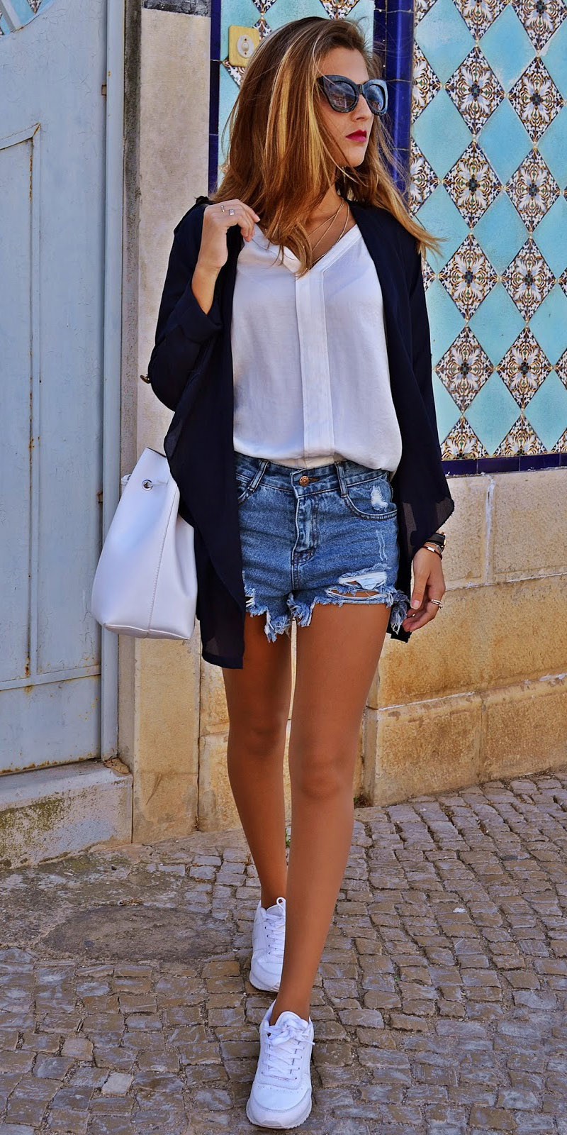 blue-med-shorts-denim-white-top-blouse-black-cardiganl-white-bag-white-shoe-sneakers-hairr-sun-spring-summer-weekend.jpg