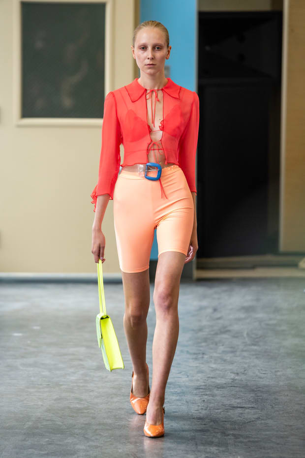 peach-shorts-cycling-bike-orange-top-blouse-sheer-yellow-bag-blonde-orange-shoe-pumps-spring-summer-lunch.jpg