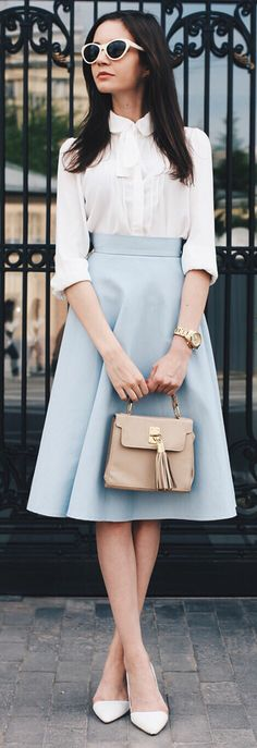 blue-light-aline-skirt-white-top-blouse-tan-bag-sun-white-shoe-pumps-bow-howtowear-fashion-style-outfit-spring-summer-brun-work.jpg