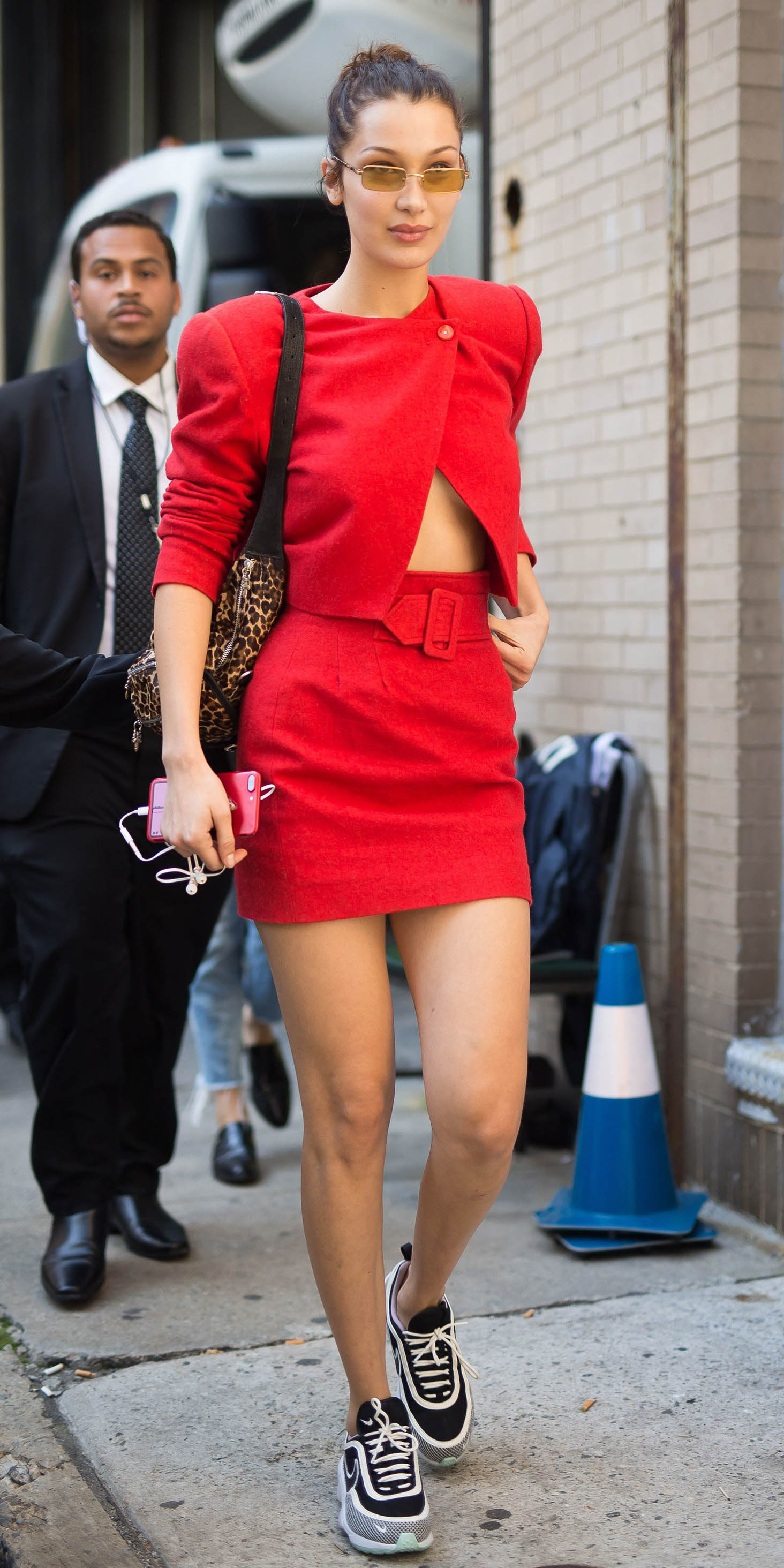 how-to-style-red-mini-skirt-bellahadid-match-set-hairr-pony-leopard-print-black-shoe-sneakers-fall-winter-fashion-streetstyle-sun-weekend.jpg