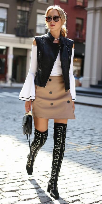 tan-mini-skirt-white-top-offshoulder-bellsleeve-black-vest-sun-pony-black-bag-black-shoe-boots-otk-blonde-fall-winter-lunch.jpg