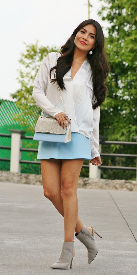 blue-light-mini-skirt-blue-bag-white-top-blouse-earrings-gray-shoe-booties-spring-summer-brun-dinner.jpg