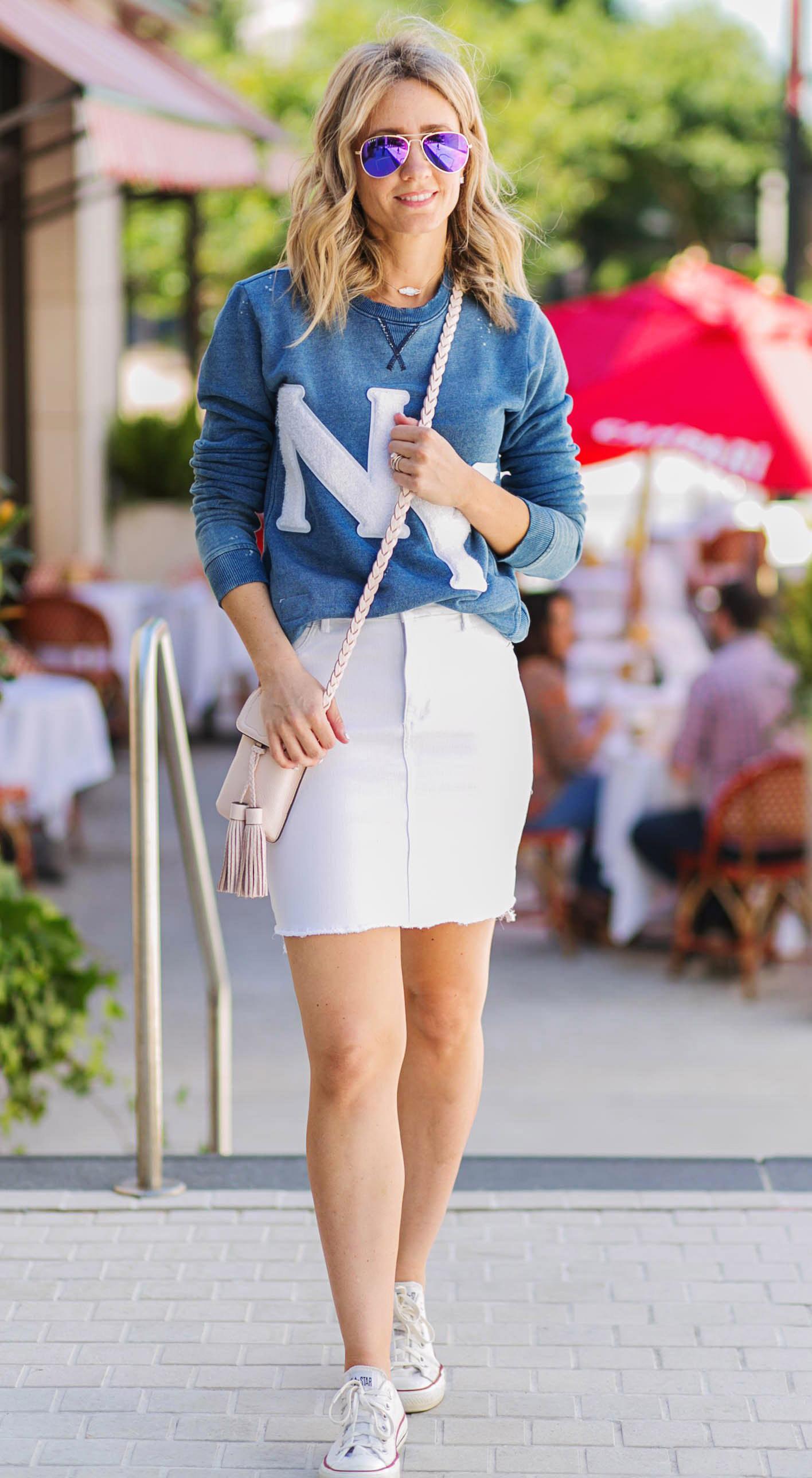white-mini-skirt-blue-med-sweater-sweatshirt-white-bag-blonde-sun-white-shoe-sneakers-spring-summer-weekend.jpg