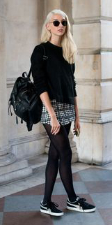 white-mini-skirt-black-sweater-print-sun-wear-style-fashion-fall-winter-black-tights-black-shoe-sneakers-black-bag-pack-blonde-weekend.jpg