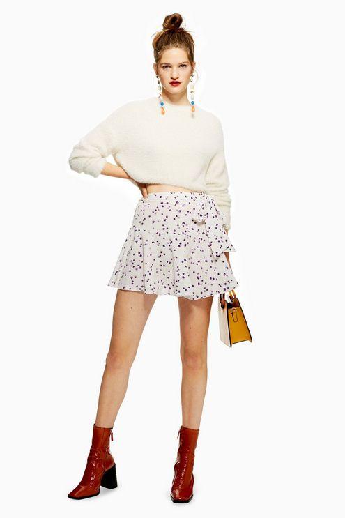 white-mini-skirt-polkadot-yellow-bag-white-sweater-earrings-bun-blonde-red-shoe-booties-fall-winter-lunch.jpg
