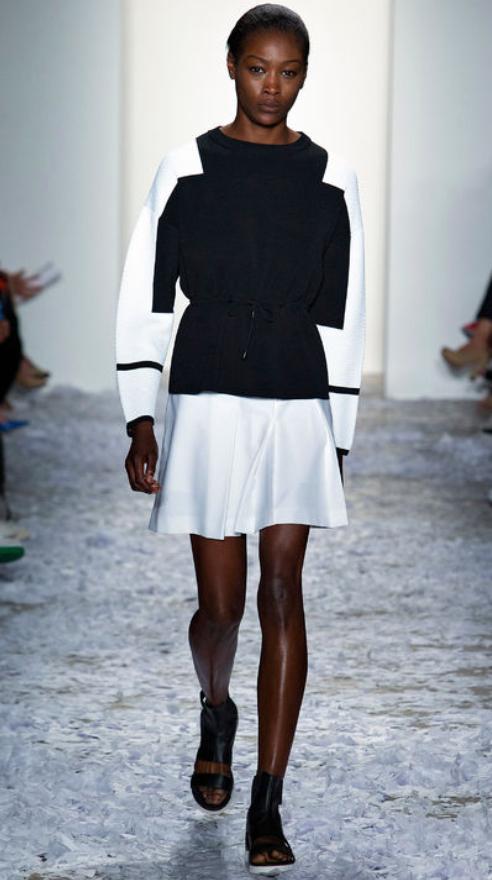 white-mini-skirt-black-sweater-bun-wear-style-fashion-spring-summer-black-shoe-sandals-brun-work.jpg