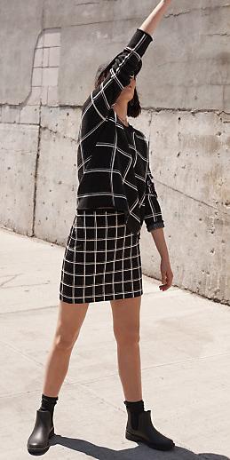 black-mini-skirt-black-sweater-windowpane-mix-prints-hat-cap-wear-style-fashion-fall-winter-black-shoe-booties-brun-weekend.jpg