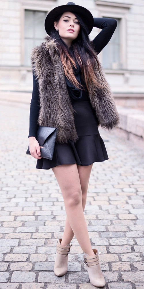 black-mini-skirt-black-top-brown-vest-fur-hat-tan-shoe-booties-black-bag-howtowear-fashion-style-outfit-fall-winter-hairr-dinner.jpg