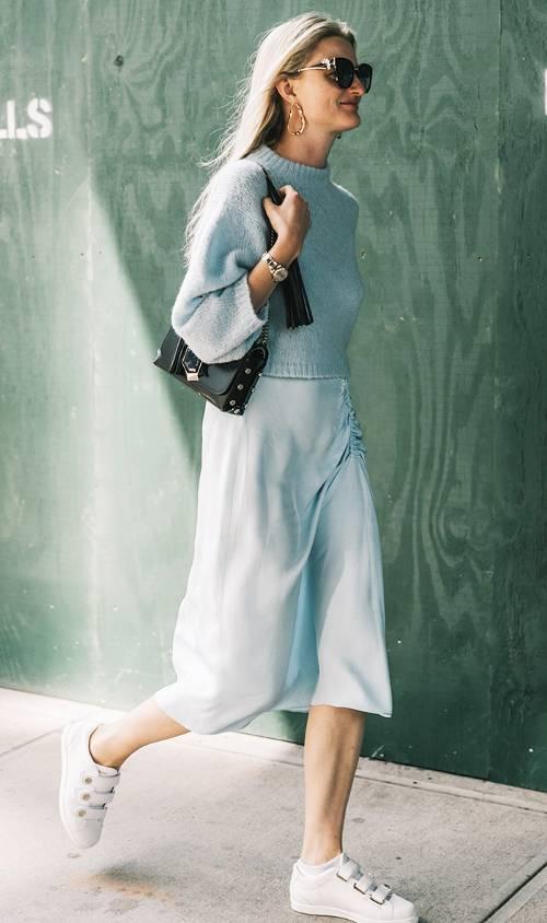 blue-light-midi-skirt-silk-blue-light-sweater-blonde-earrings-black-bag-white-shoe-sneakers-spring-summer-lunch.jpg