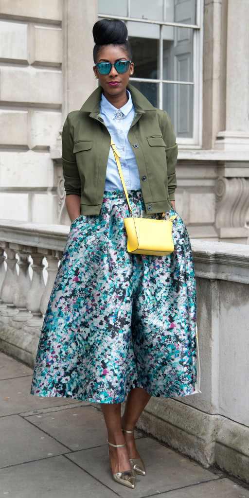 blue-med-midi-skirt-print-blue-light-collared-shirt-yellow-bag-sun-bun-tan-shoe-pumps-gold-green-olive-jacket-utility-spring-summer-brun-lunch.jpg