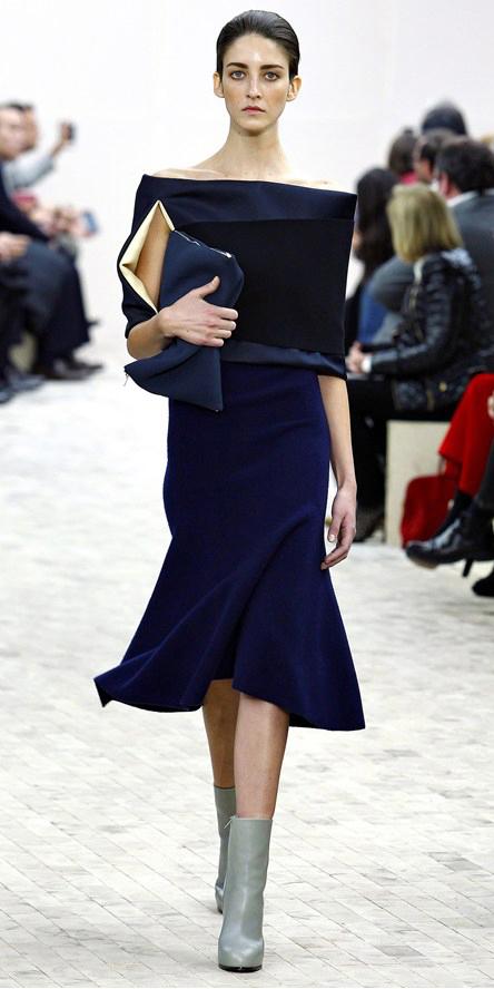 blue-navy-midi-skirt-blue-navy-top-bun-wear-outfit-fall-winter-gray-shoe-booties-fashion-offshoulder-brun-dinner.jpg