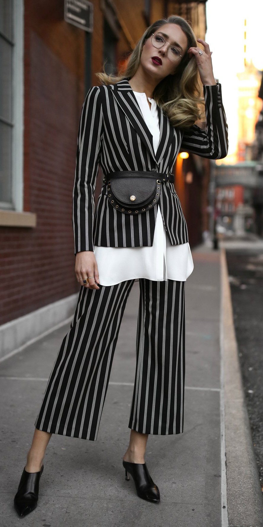black-culottes-pants-pinstripe-suit-white-collared-shirt-black-bag-fannypack-black-shoe-booties-blonde-black-jacket-blazer-fall-winter-lunch.jpg