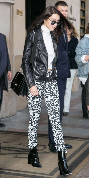 white-leggings-print-white-tee-turtleneck-sun-black-bag-black-shoe-booties-bellahadid-black-jacket-moto-fall-winter-brun-lunch.jpg