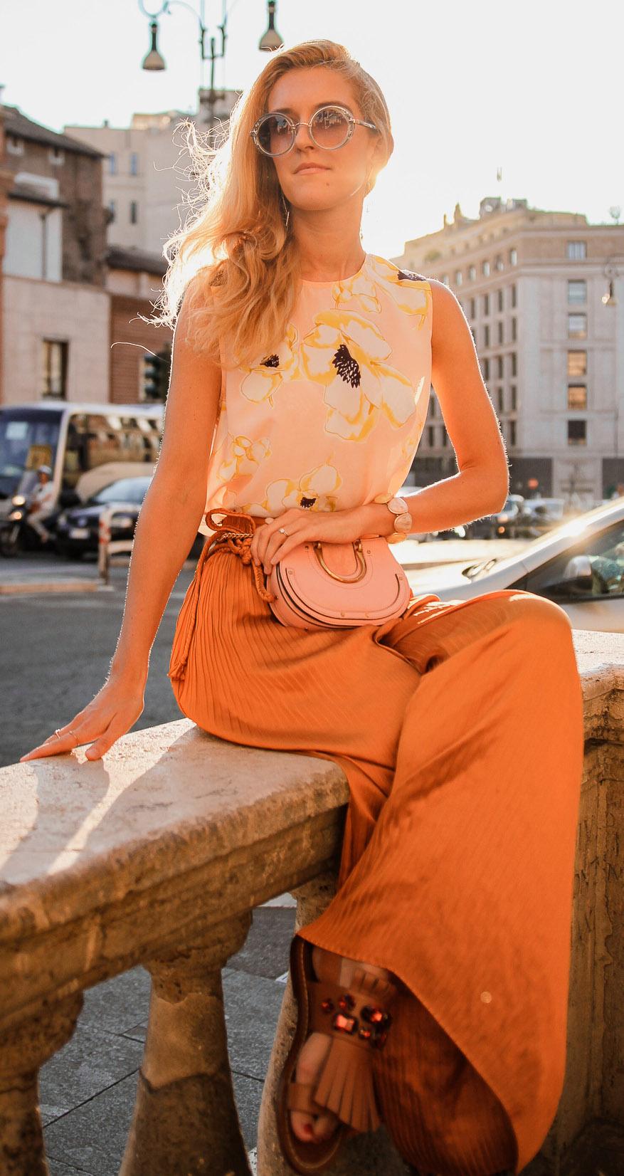 orange-wideleg-pants-peach-bag-fannypack-cognac-shoe-sandals-blonde-sun-yellow-top-floral-print-tonal-spring-summer-lunch.jpg