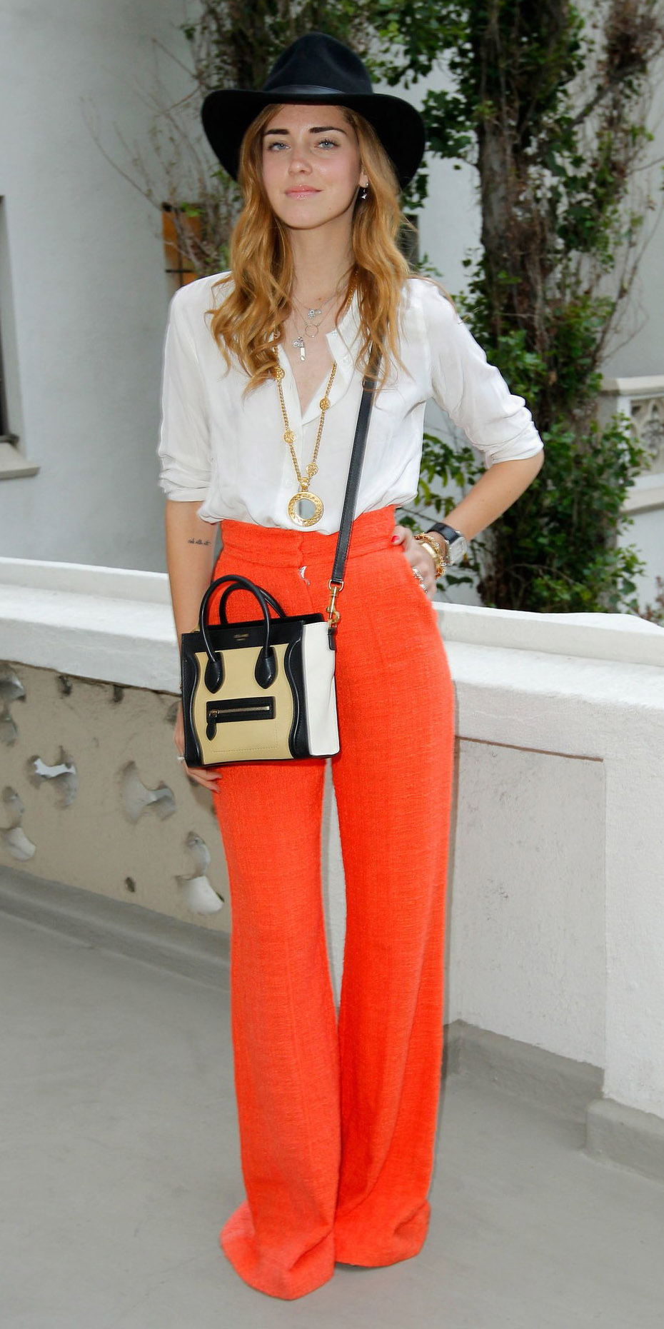 how-to-style-orange-wideleg-pants-white-top-blouse-blonde-hat-fall-winter-fashion-lunch.jpg