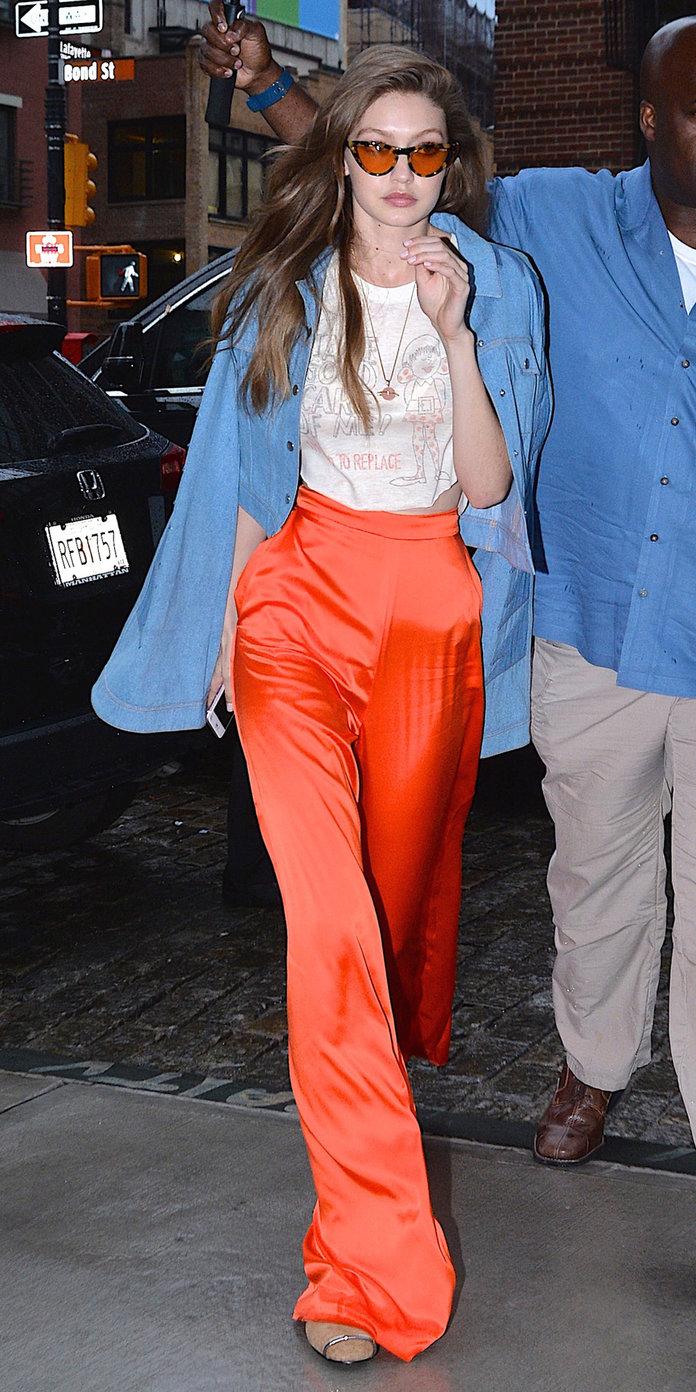 orange-wideleg-pants-white-crop-top-blonde-gigihadid-blue-light-jacket-jean-sun-spring-summer-lunch.jpg
