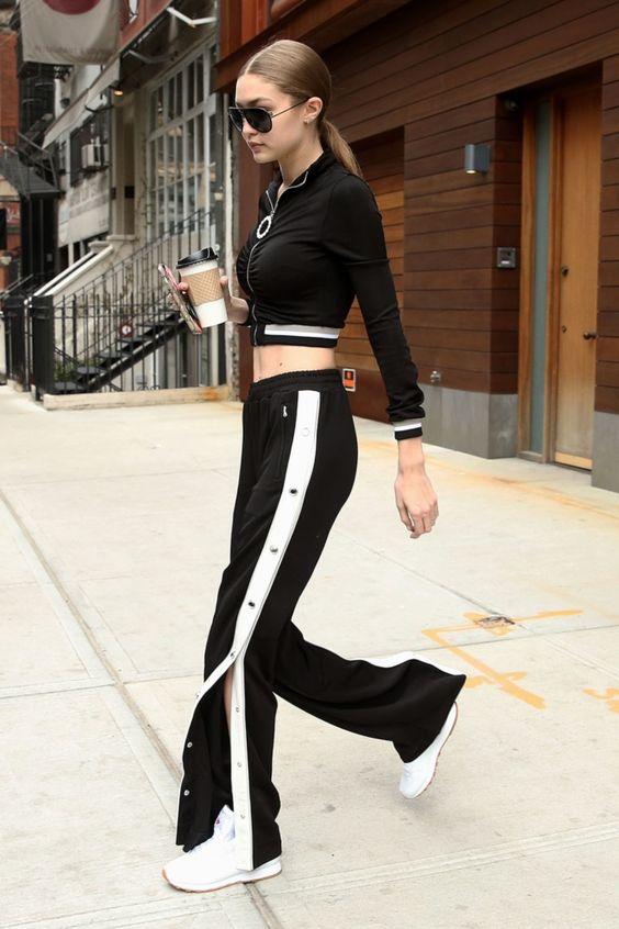 black-wideleg-pants-tracksuit-black-jacket-bomber-pony-blonde-sun-white-shoe-sneakers-gigihadid-fall-winter-lunch.jpg