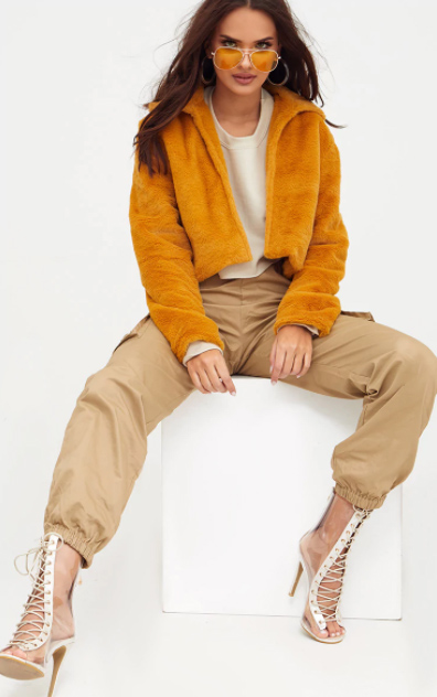 tan-joggers-pants-hoops-sun-clear-shoe-booties-yellow-jacket-coat-fur-fuzz-fall-winter-brun-lunch.jpg