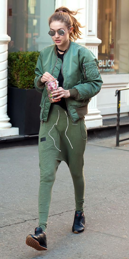 green-olive-joggers-pants-black-tee-blonde-sun-pony-gigihadid-black-shoe-sneakers-green-olive-jacket-bomber-fall-winter-weekend.jpg