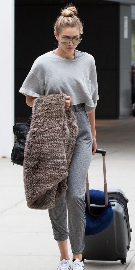 grayl-joggers-pants-sweats-blonde-bun-sun-grayl-sweater-sweatshirt-gigihadid-white-shoe-sneakers-travel-airport-fall-winter-weekend.jpg