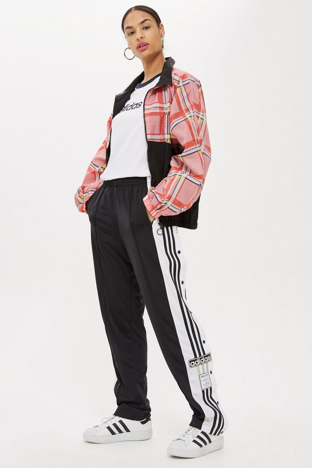black-joggers-pants-trackpants-white-graphic-tee-pink-light-jacket-bomber-brun-bun-hoops-white-shoe-sneakers-fall-winter-weekend.jpg