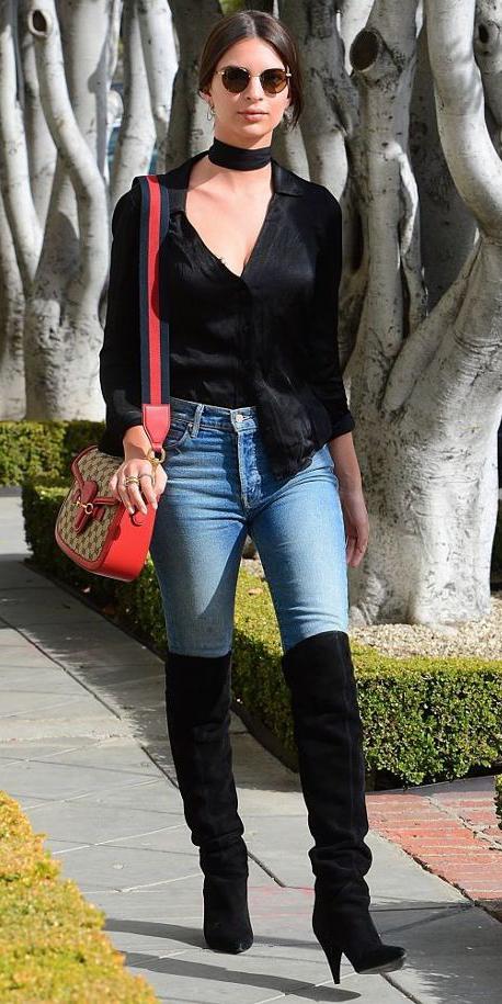 blue-light-skinny-jeans-black-shoe-boots-red-bag-black-blouse-brun-bun-sun-datenight-emilyratajkowskis-fall-winter-dinner.jpg