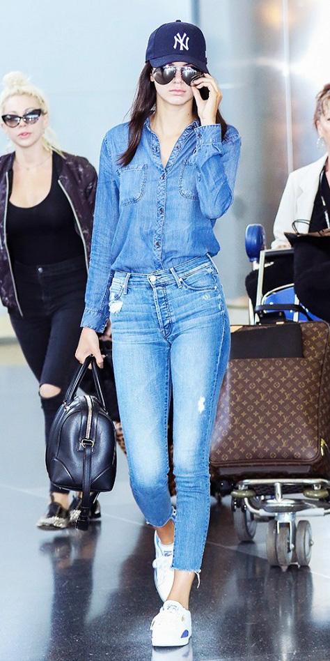 blue-light-skinny-jeans-blue-light-collared-shirt-wear-spring-summer-outfit-chambray-hat-cap-white-shoe-sneakers-black-bag-sun-kendalljenner-travel-brun-weekend.jpg