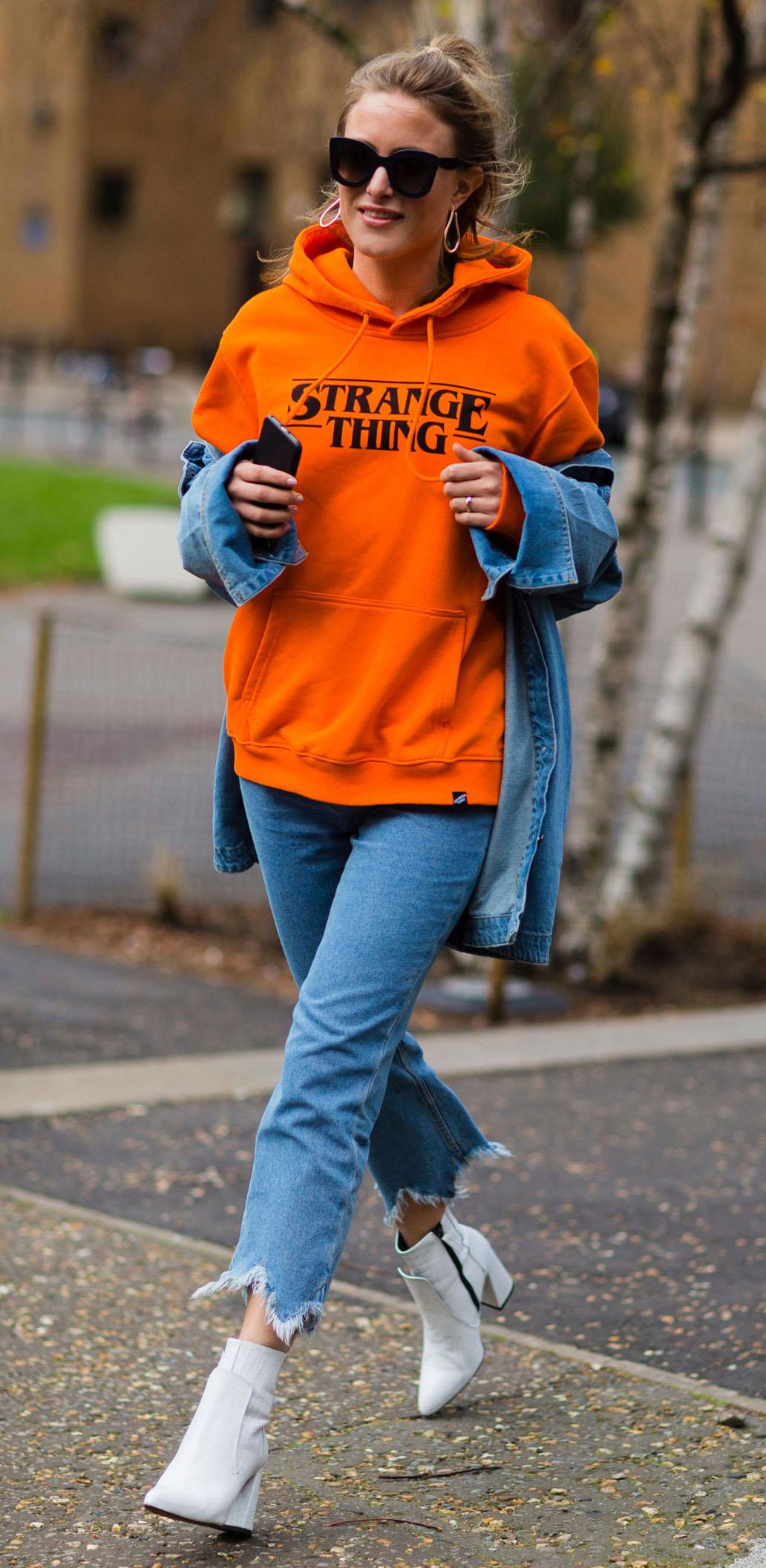 blue-med-crop-jeans-orange-sweater-sweatshirt-hoodie-graphic-blonde-sun-pony-white-shoe-booties-blue-med-jacket-jean-fall-winter-lunch.jpg