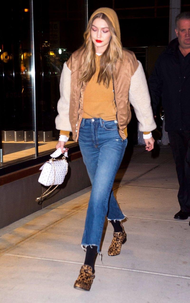 blue-med-crop-jeans-black-tights-yellow-shoe-booties-leopard-print-yellow-sweater-sweatshirt-hoodie-blonde-gigihadid-white-bag-camel-jacket-bomber-fall-winter-weekend.jpg