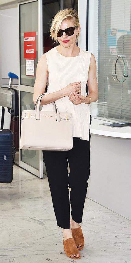 black-slim-pants-white-sweater-sleeveless-white-bag-cognac-shoe-sandalh-mules-blonde-sun-siennamiller-spring-summer-lunch.jpg