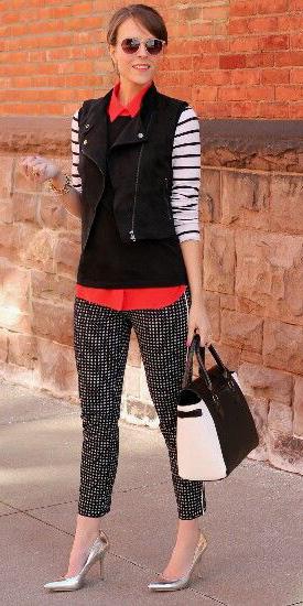 black-slim-pants-orange-collared-shirt-black-sweater-sleeveless-black-vest-moto-bun-hairr-black-bag-sun-stripe-fall-winter-work.jpg