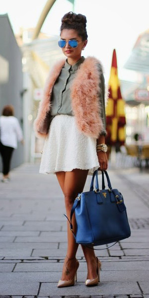 white-mini-skirt-green-olive-top-blouse-pink--light-vest-fur-fuzz-bun-sun-blue-bag-tan-shoe-pumps-fall-winter-brun-lunch.jpg