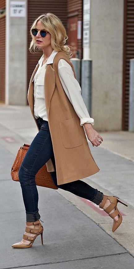 blue-navy-skinny-jeans-white-top-blouse-camel-vest-tailor-blonde-pony-sun-cognac-bag-cognac-shoe-pumps-fall-winter-work.jpg