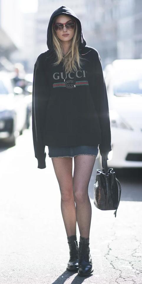 blue-navy-mini-skirt-denim-black-tights-fishnet-black-bag-black-shoe-booties-black-sweater-sweatshirt-hoodie-blonde-sun-fall-winter-weekend.jpg