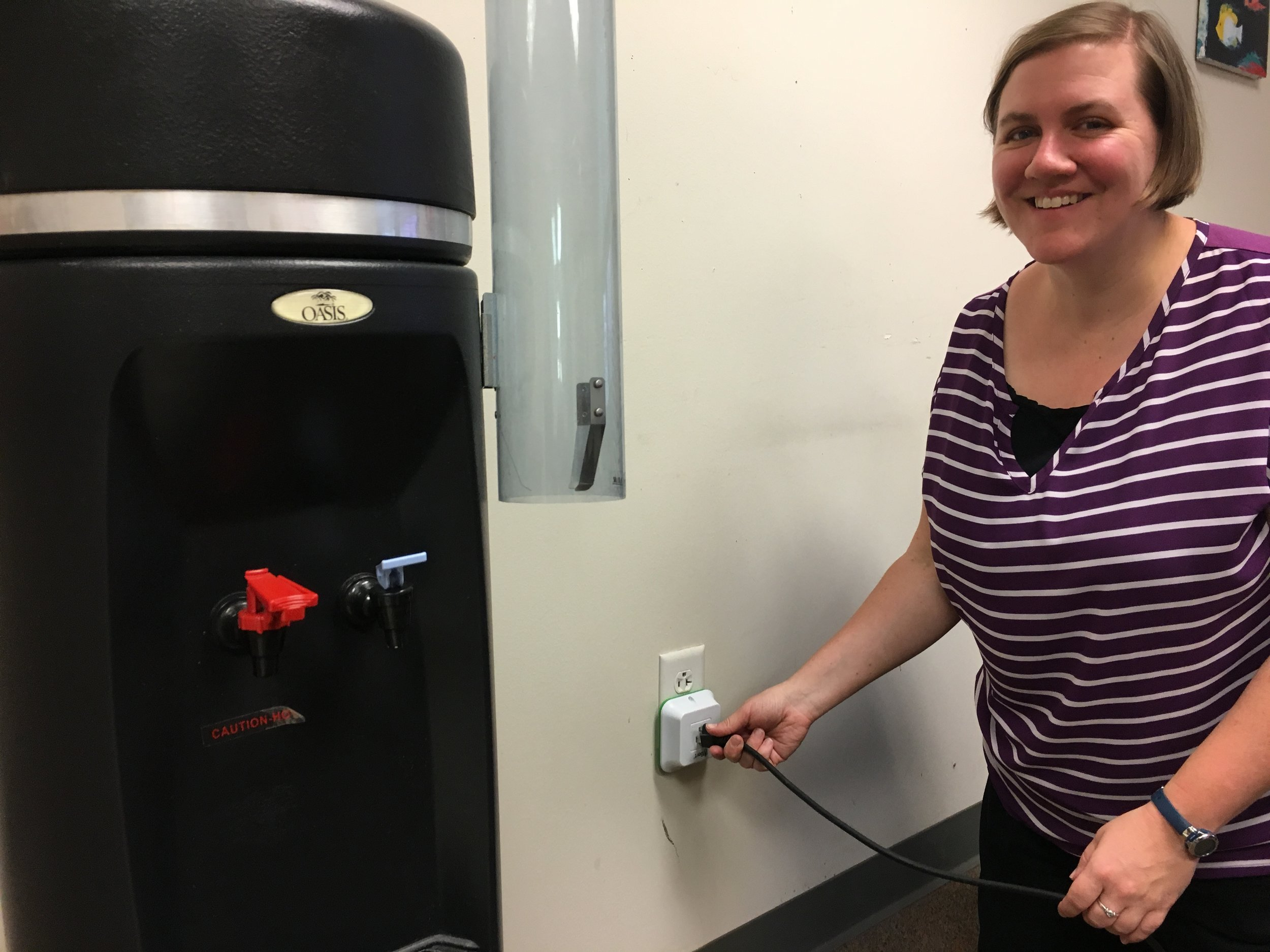 SCH's Upper School Science Teacher, Ellen Kruger, plugging in a BERT device to measure energy consumption.
