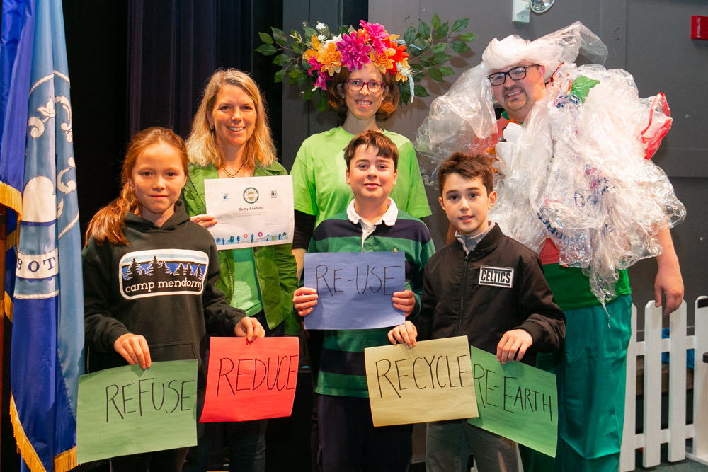 Anne Benjamin, Anne Sudduth as Mother Earth, David Kleberg as Bag Monster, and members of the Derby Academy Sustainability Club receiving the National Wildlife Federation Eco Schools Bronze Award