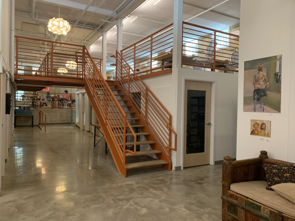 The coworking hub is characterized by its modern industrial design and 3 levels of work space.