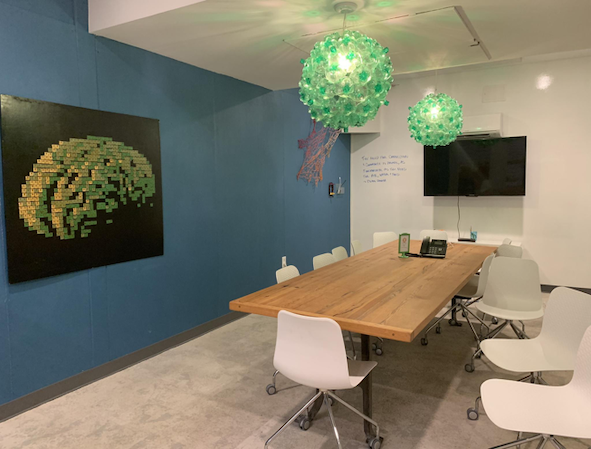 Conference rooms contain art from plastic bread tabs and repurposed bottle chandeliers.