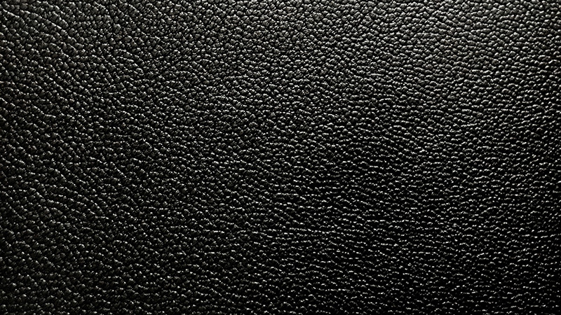 Black corrected leather with an artificial grain pattern.